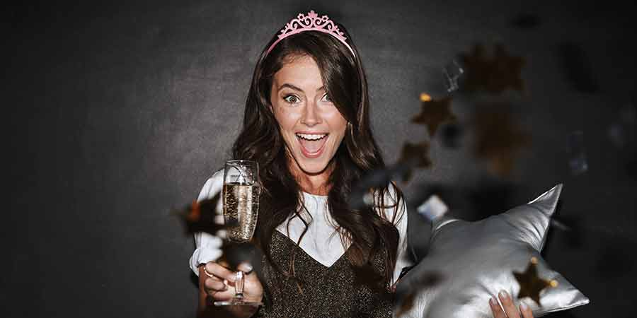 Image of social media influencer, crown, champagne, star pillow