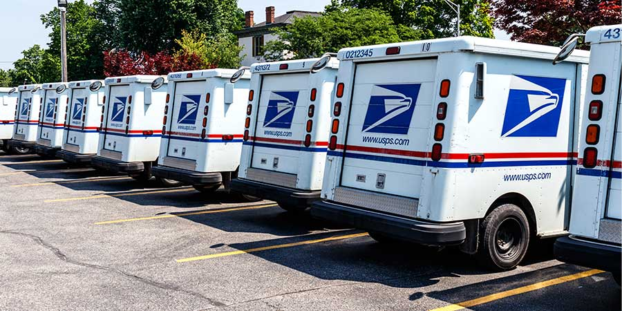 line of mail trucks...every door direct united states postal service